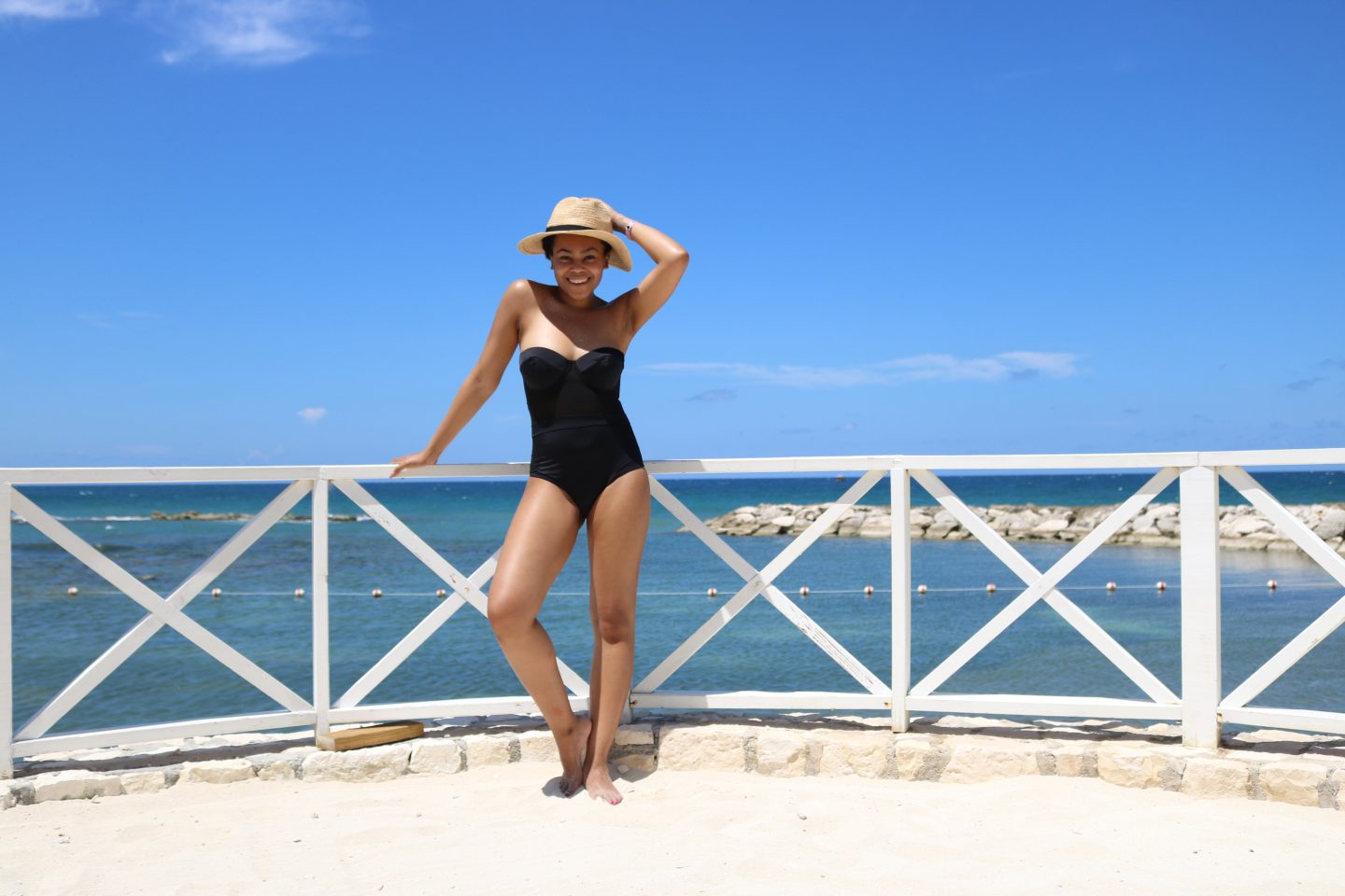 full black swimsuit straw hat